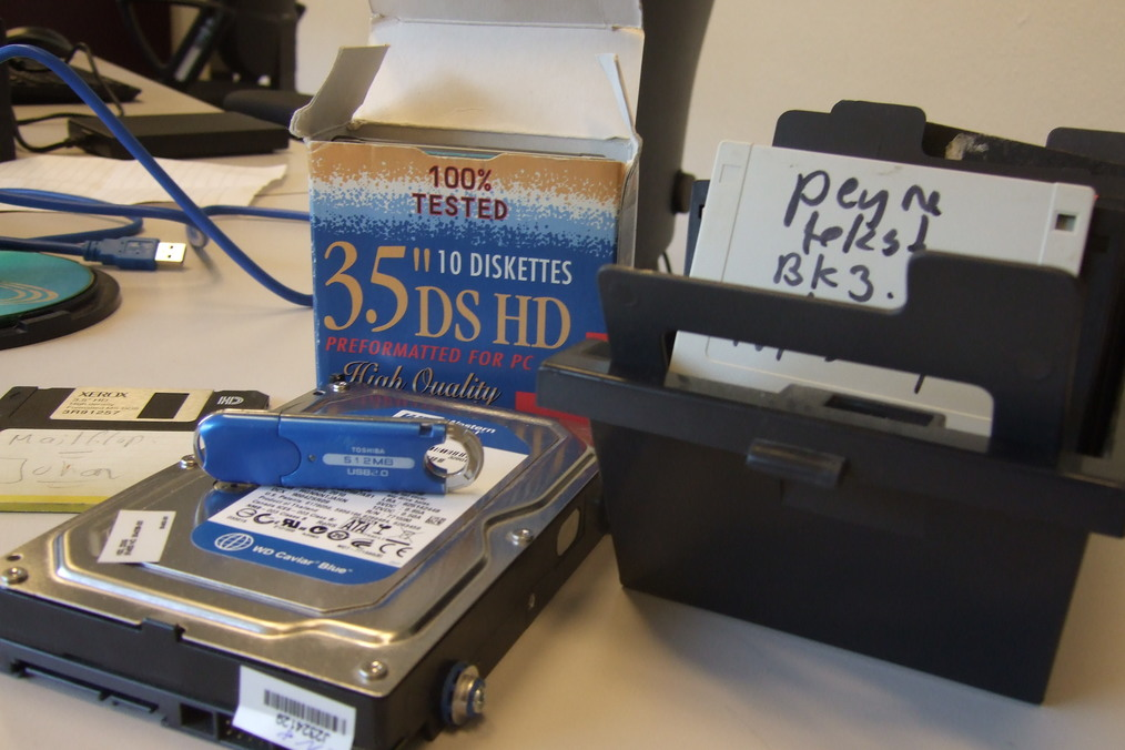 Photograph of SATA hard disk, USB Flash drive and 3.5 floppy disks